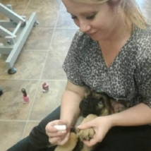 Nicole painting her puppy Denali's nails